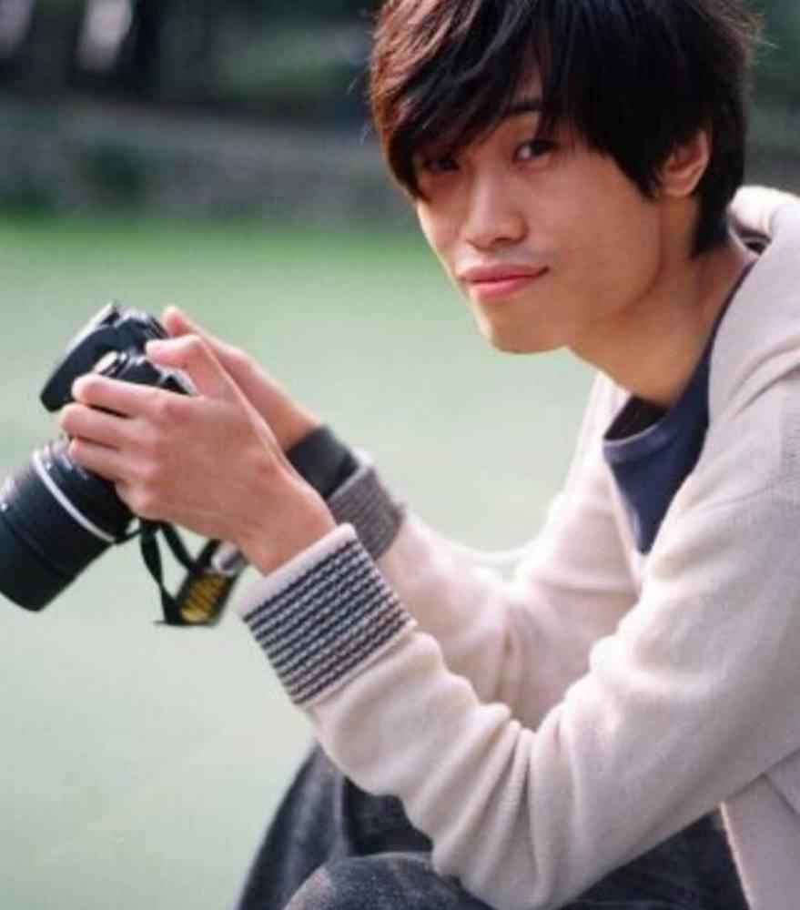 胡启明来自香港,是国家中级职业摄影师。